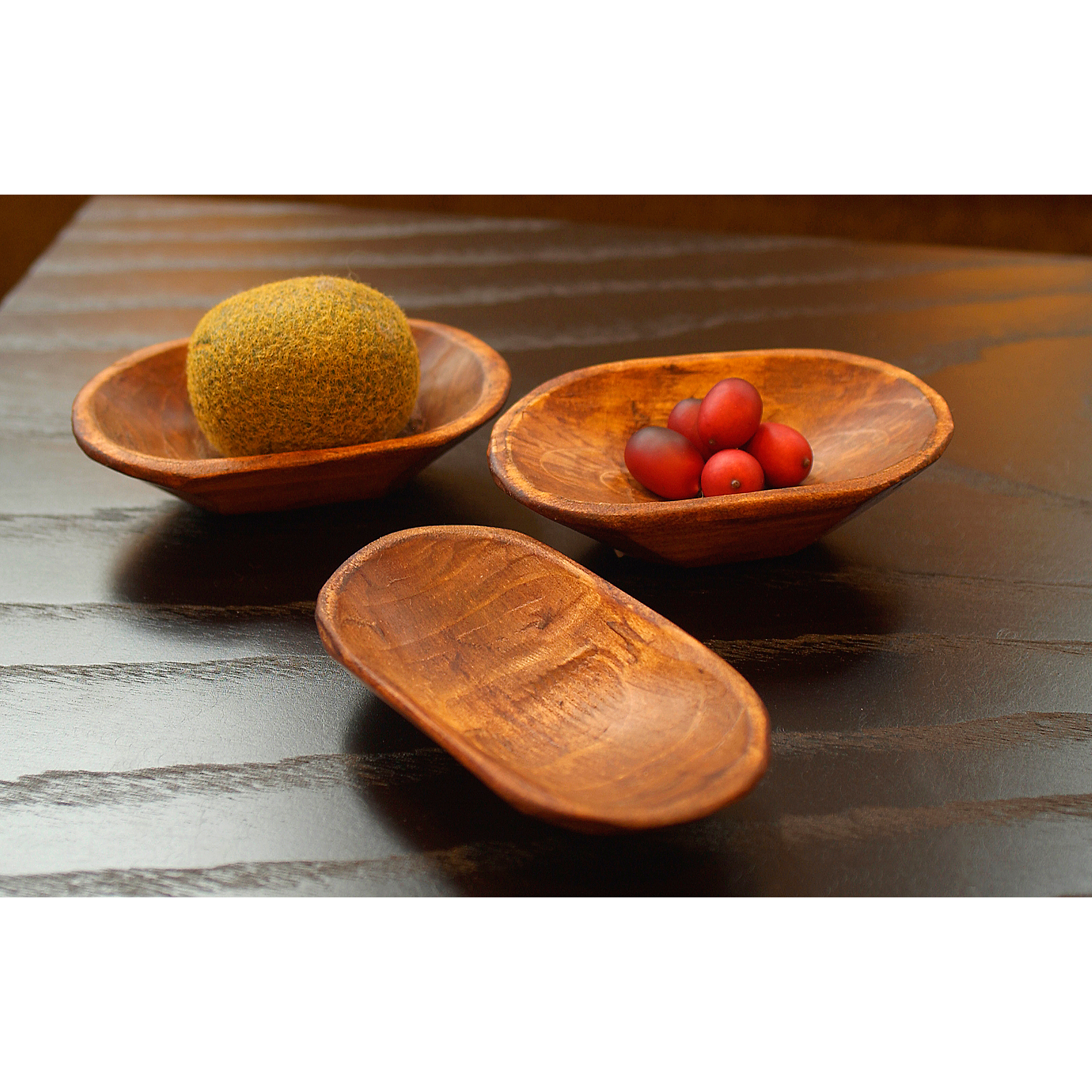 Photo of wooden scoops and berries