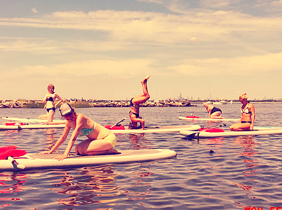 SUP Yoga and Pilates from A-Team Paddleboarding
