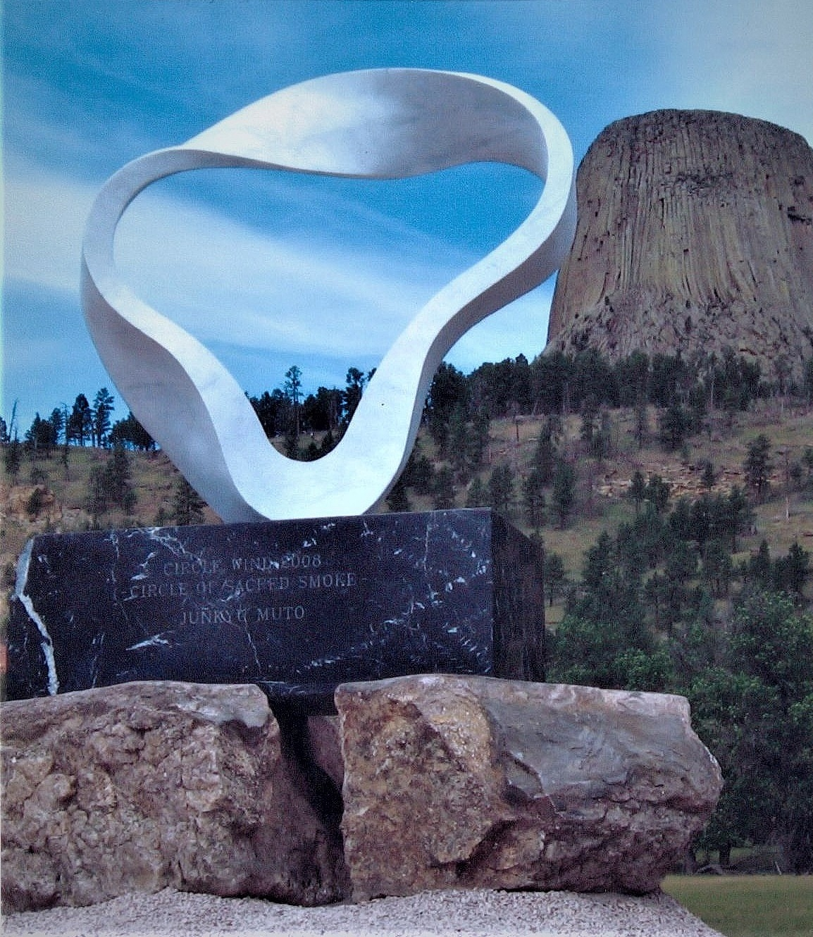 """The wind circle """"circle of smoke"""" sculpture by Junko Muto Wilen set and carved """"Crazy Horse stones"""" to support sculpture at Devils tower, Wyoming"""