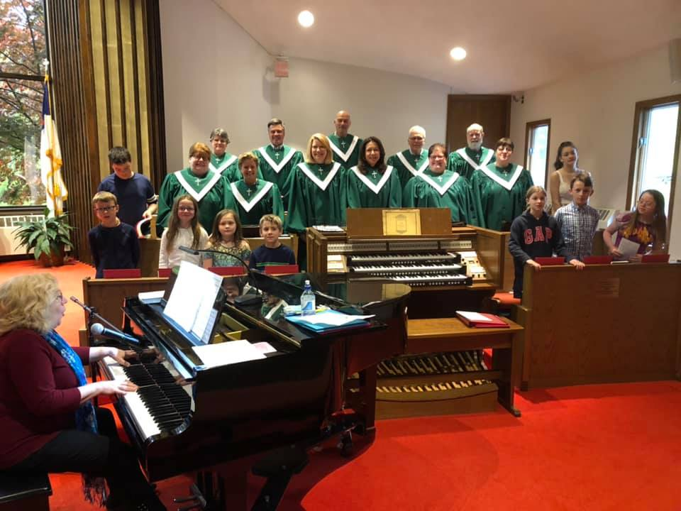 Our Adult and Children's Choirs singing