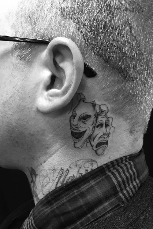 Jose Araujo drama faces neck Tattoo.jpg