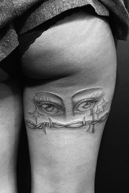 Jose Araujo Eyes Barbed Wire Tattoo.jpg