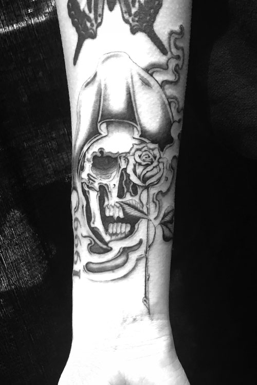 Jose Araujo Grim Reaper Rose Tattoo.jpg