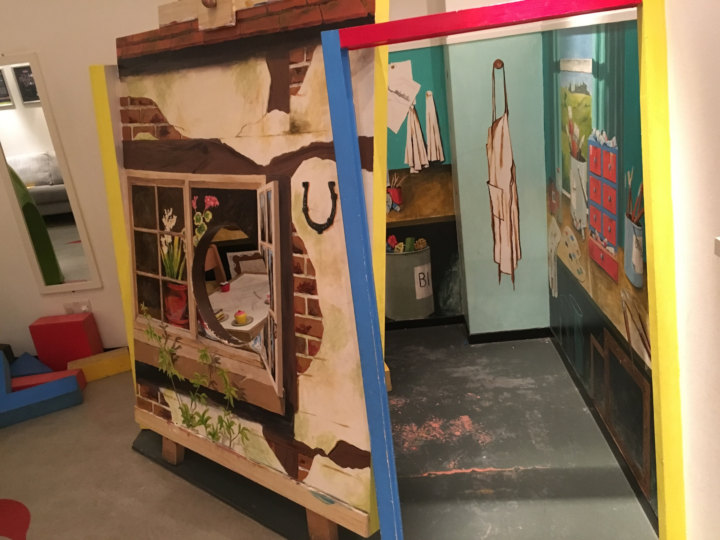 You can't see well from this photo, but this was a miniature house for kids to go into. It was decorated with lots of wall stickers, and through the window you can just see there was a table and chairs set up with some food pieces to play with.