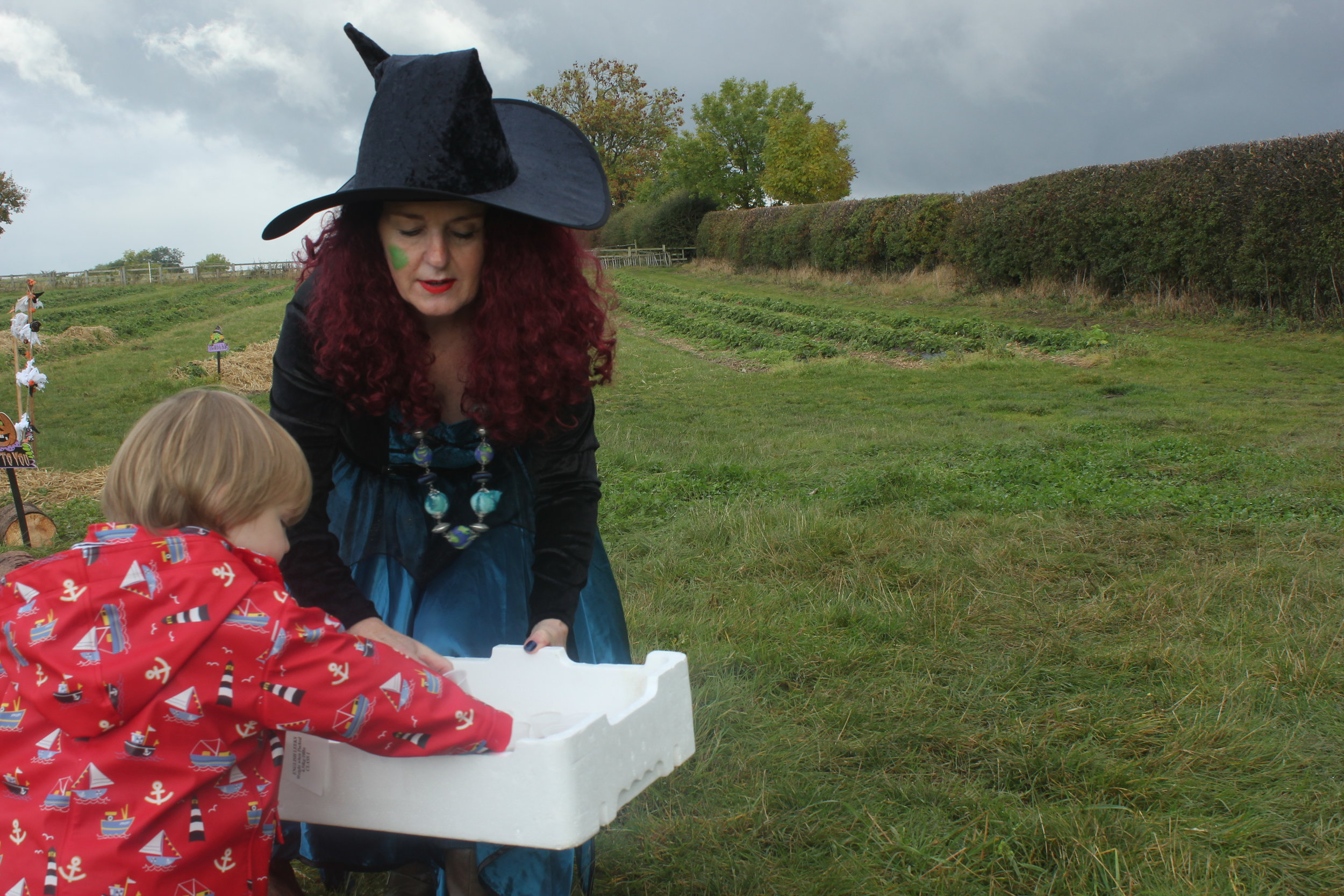 Brocksbushes farm shop and tea room Halloween 2016 Northumberland pumpkin patch kids events baby toddler. Eileen and Joe children's entertainer dressed as a witch, with a toddler.