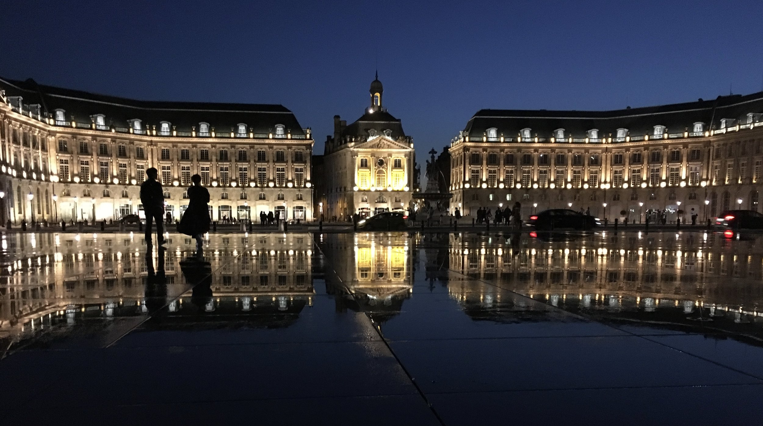 """Miroir d'Eau,"" the world's largest reflection pool, sits on the door step of the Place de la Bourse and is a refreshing place to cool off on a warm day. It's like a day at the pool for kids and at night, the reflecting pool is a stunning setting for couples looking for a little romance."