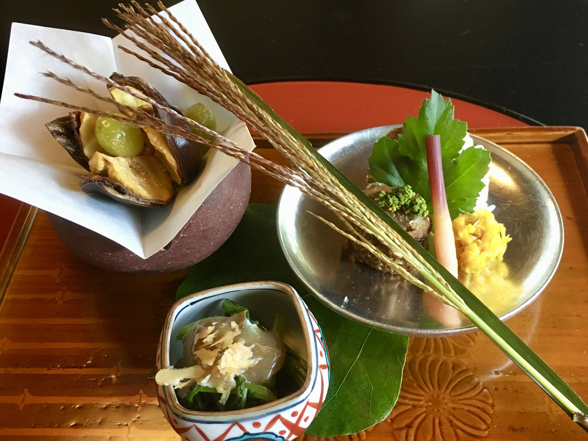 Edible chrysanthemum with gluten cake dressed with walnut sauce, Barracuda sushi, Deep fried chestnut, Simmered burdock and grilled conger eel roll, Ginkgo