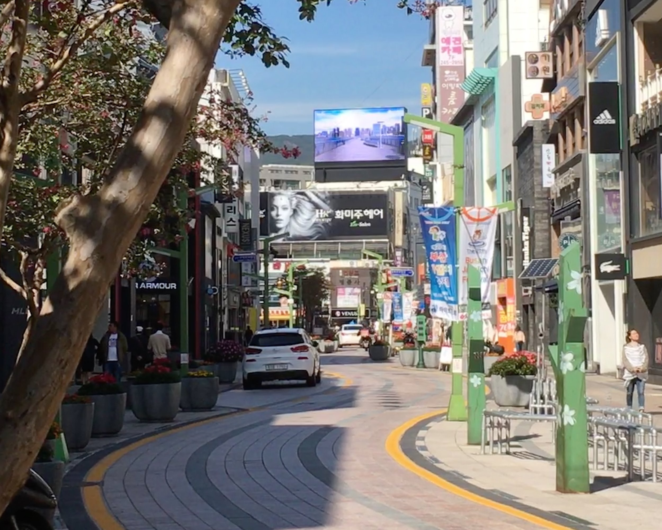 "9. Take a stroll along Gwangbok-ro Street - This street used to be a stream but was covered over around 1895 because the area had become overpopulated and the water polluted. Today, the street mimics the curvy shape of the meandering stream and is lined with vibrant flowers and bronze sculptures. The street means ""independence,"" so it's also known as Independence Road. After the Korean War, refugees and returning locals set about establishing the street as a successful commercial area with cinemas, restaurants and shops. It is still a lively area filled with shops, boutiques and cafes. Bonus tip: You can catch an escalator from this street that will transport you up the hill to Yeongdusan Park and Busan Tower."