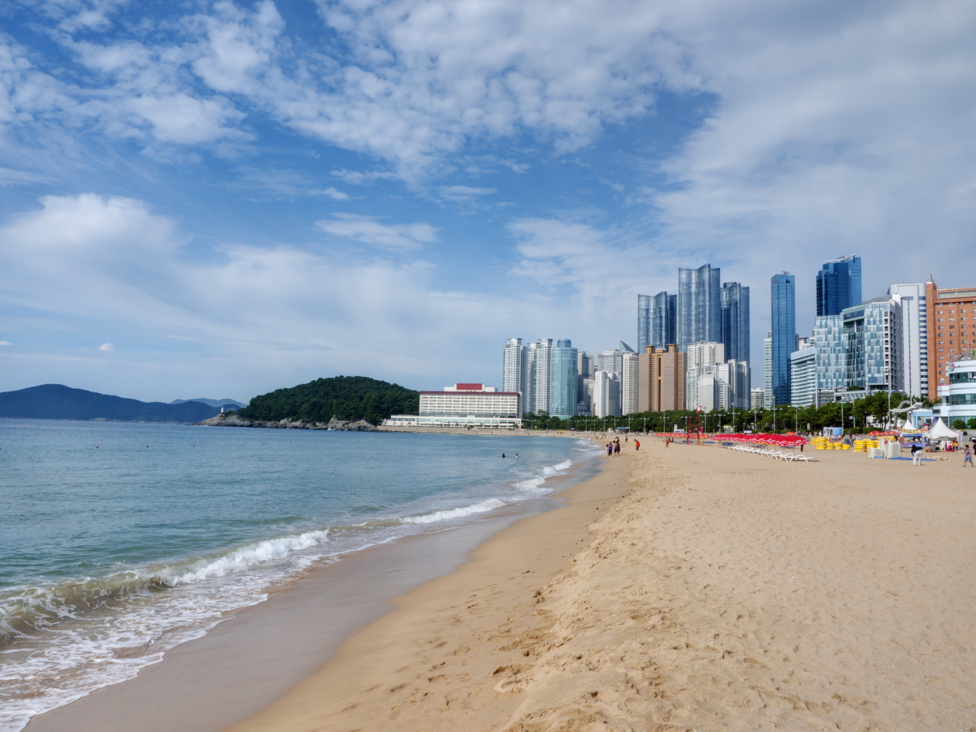 11. Spend an afternoon on Haeundae Beach - Haeundae is Busan's most famous beach and is a popular vacation destination for many Koreans and tourists alike during the summer. This beautiful white sand beach with a shallow bay is the perfect spot for sunbathing, swimming and people watching.
