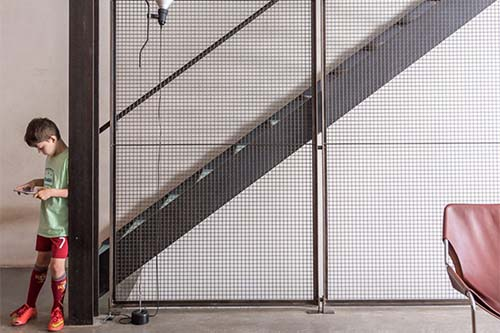 Contemporary stairs with art mesh screen
