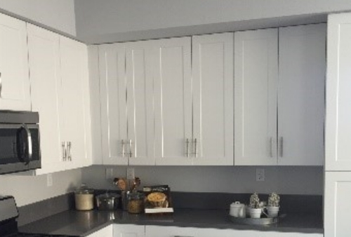 Real wood shaker style white cabinets