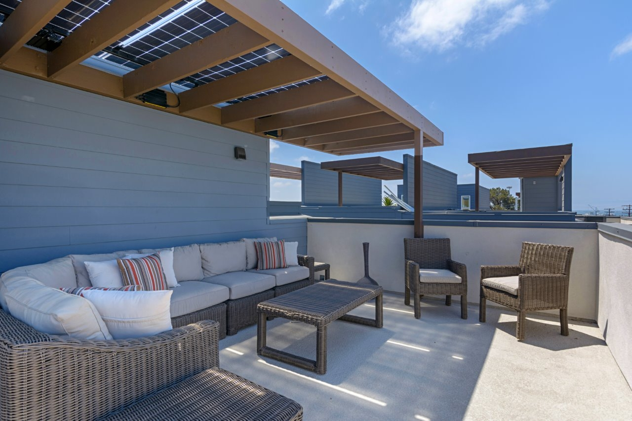 Optional translucent solar panels are concealed in the patio covers.