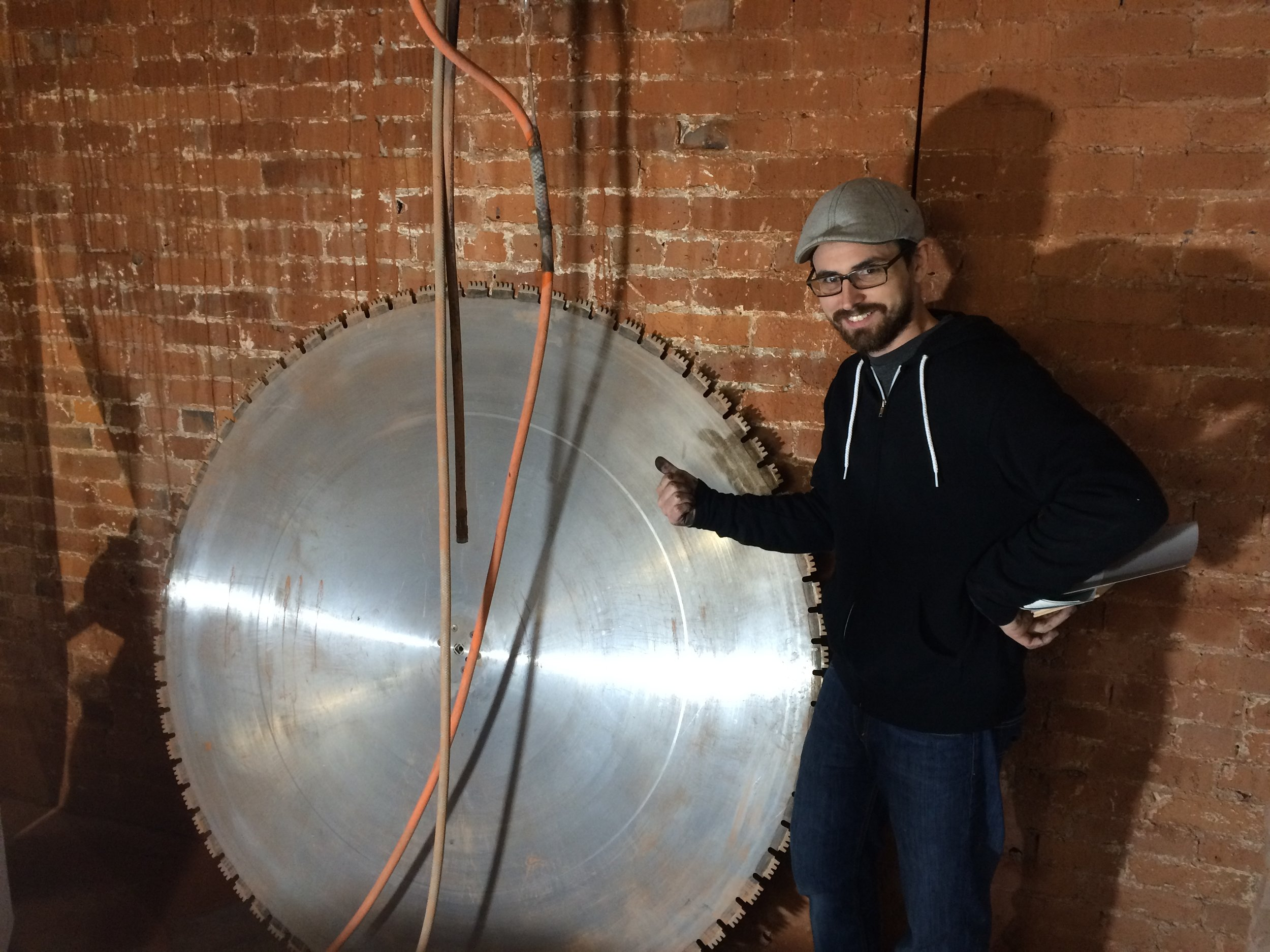 """ABOVE: The 5' saw that cut through the 25"""" thick concrete wall previously separating what was originally the basement of two different buildings."""