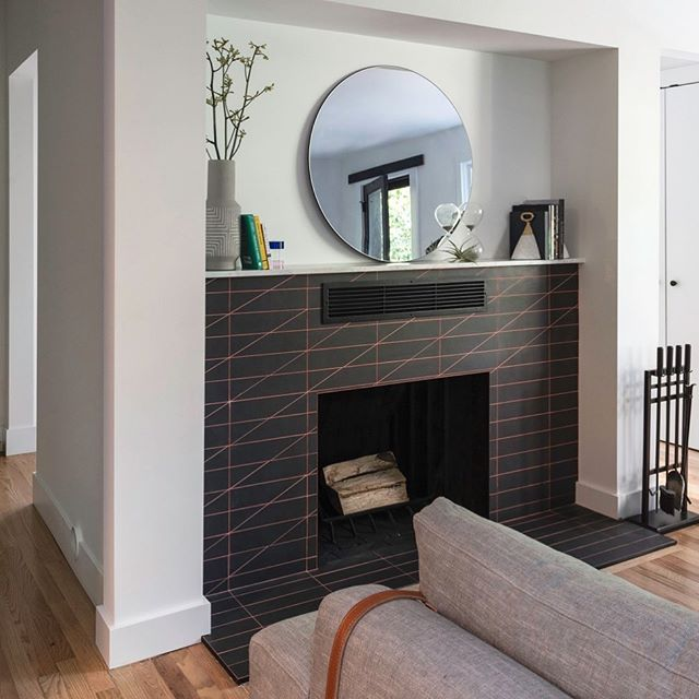 Who says you can't use hot pink grout? This fireplace design in a recent remodel adds this pop of color and geometric style to what could otherwise be a boring black fireplace.