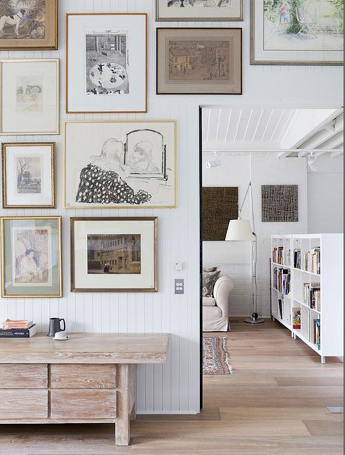 HALLWAY GALLERY WALL | via  The Style Files