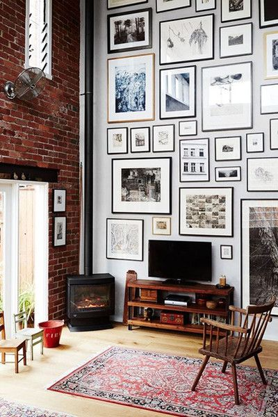 LIVING ROOM GALLERY WALL | lofted ceiling | via  Lonny