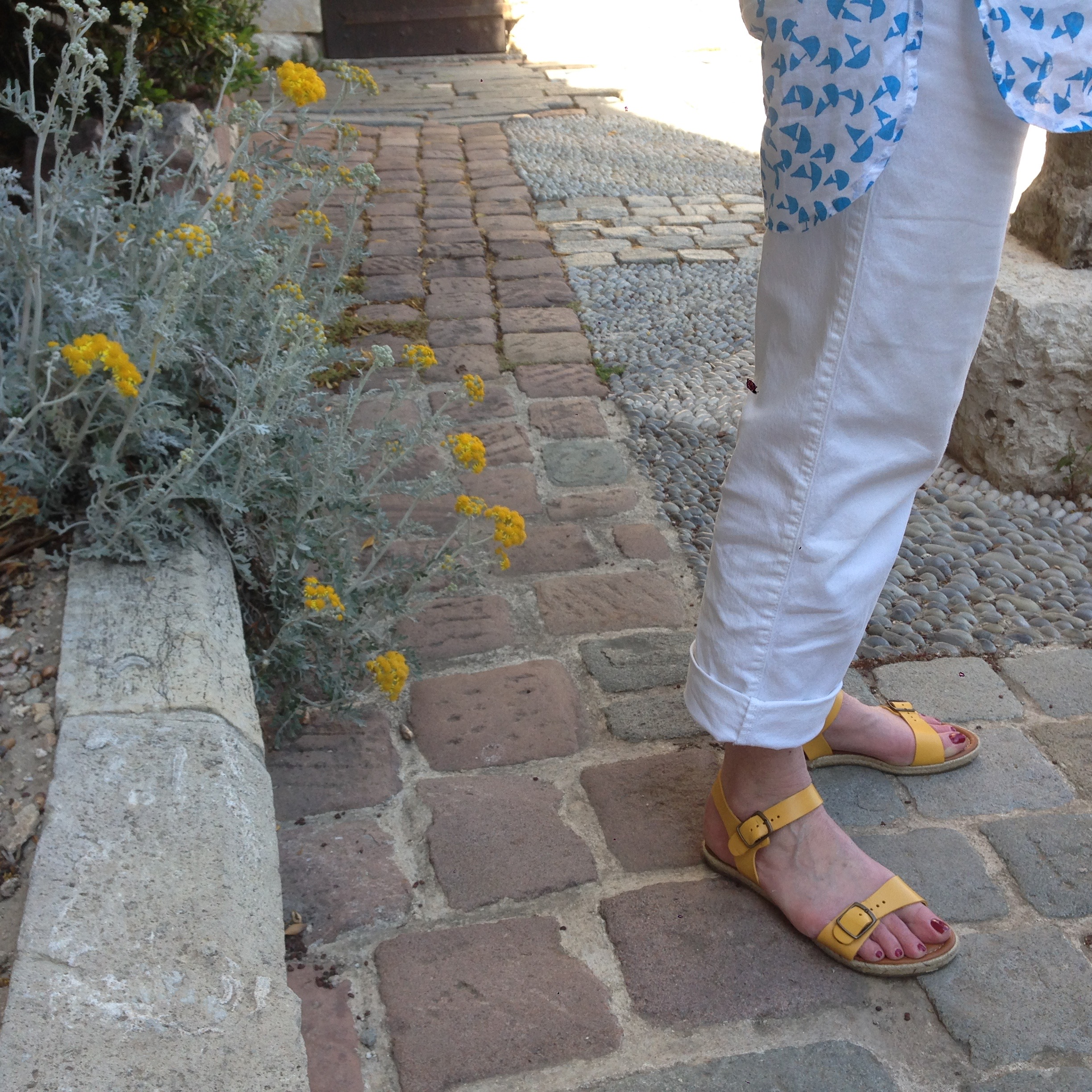 Yellow sandals and yellow flowers on the terrace of the Picasso Museum, Antibes