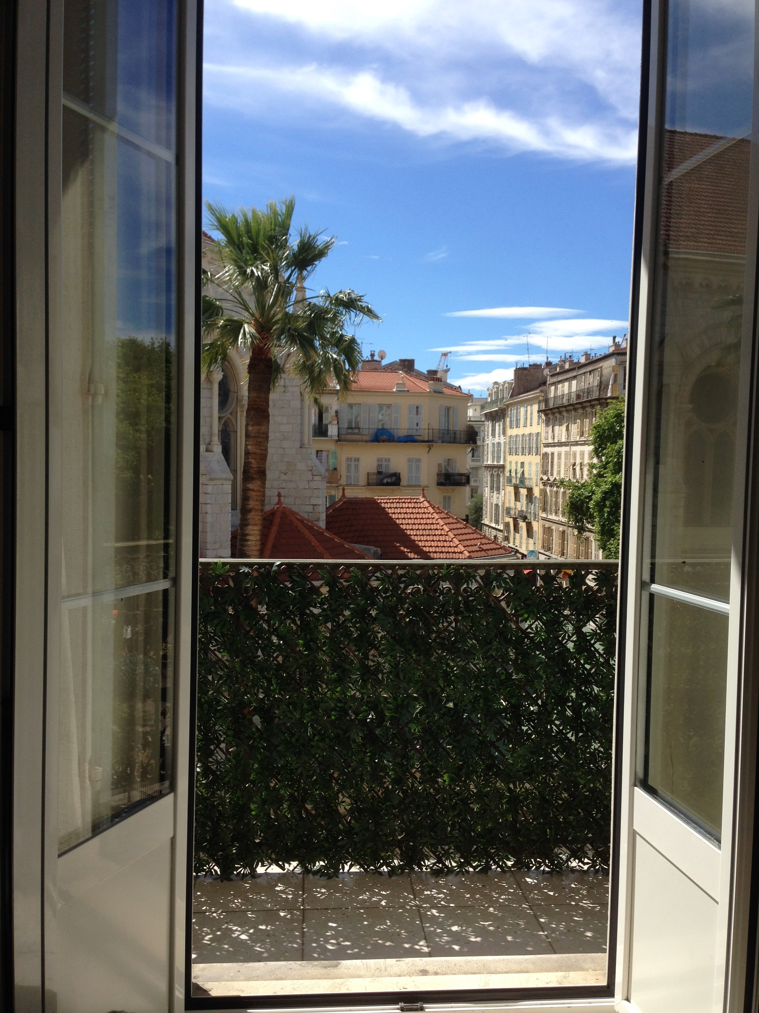 An open window in our rented apartment in Nice, overlooking the Basilica Notre Dame.