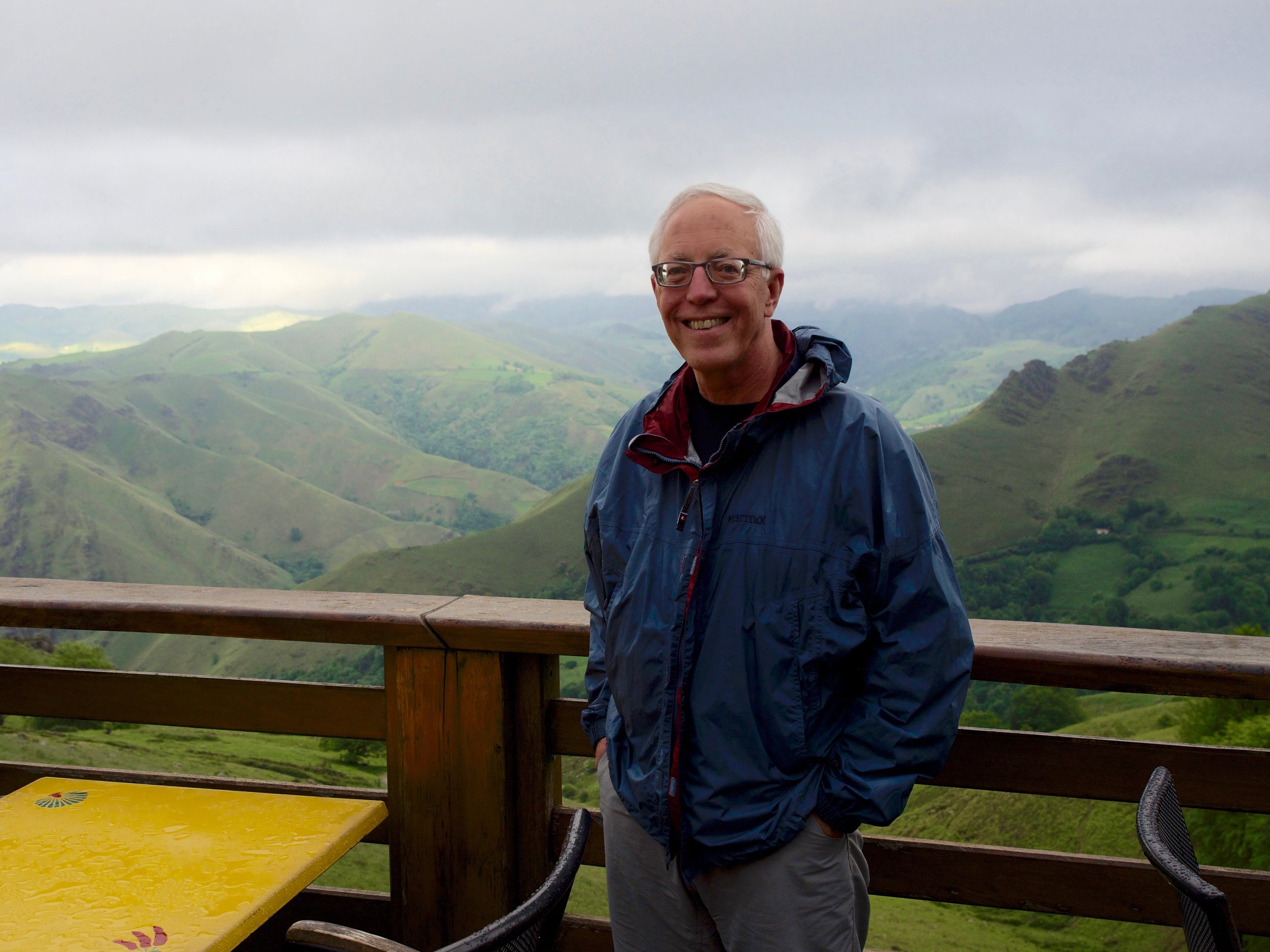 Our teammate wearing his Marmot Precip Jacket on a rainy day in Orisson, crossing the Pyrenees.
