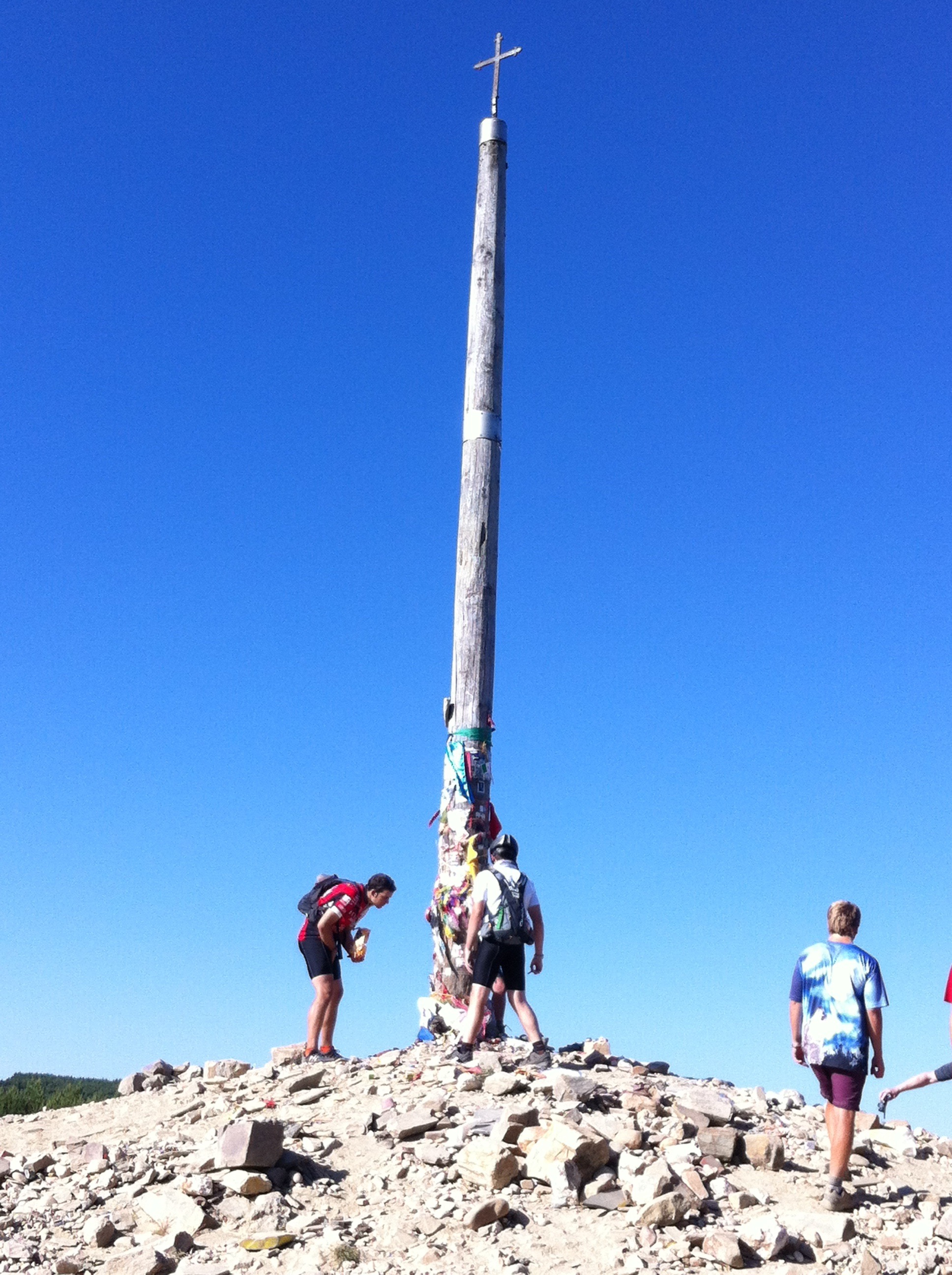 Pilgrims lay their burdens and prayers at the foot of the  Cruz de Ferro