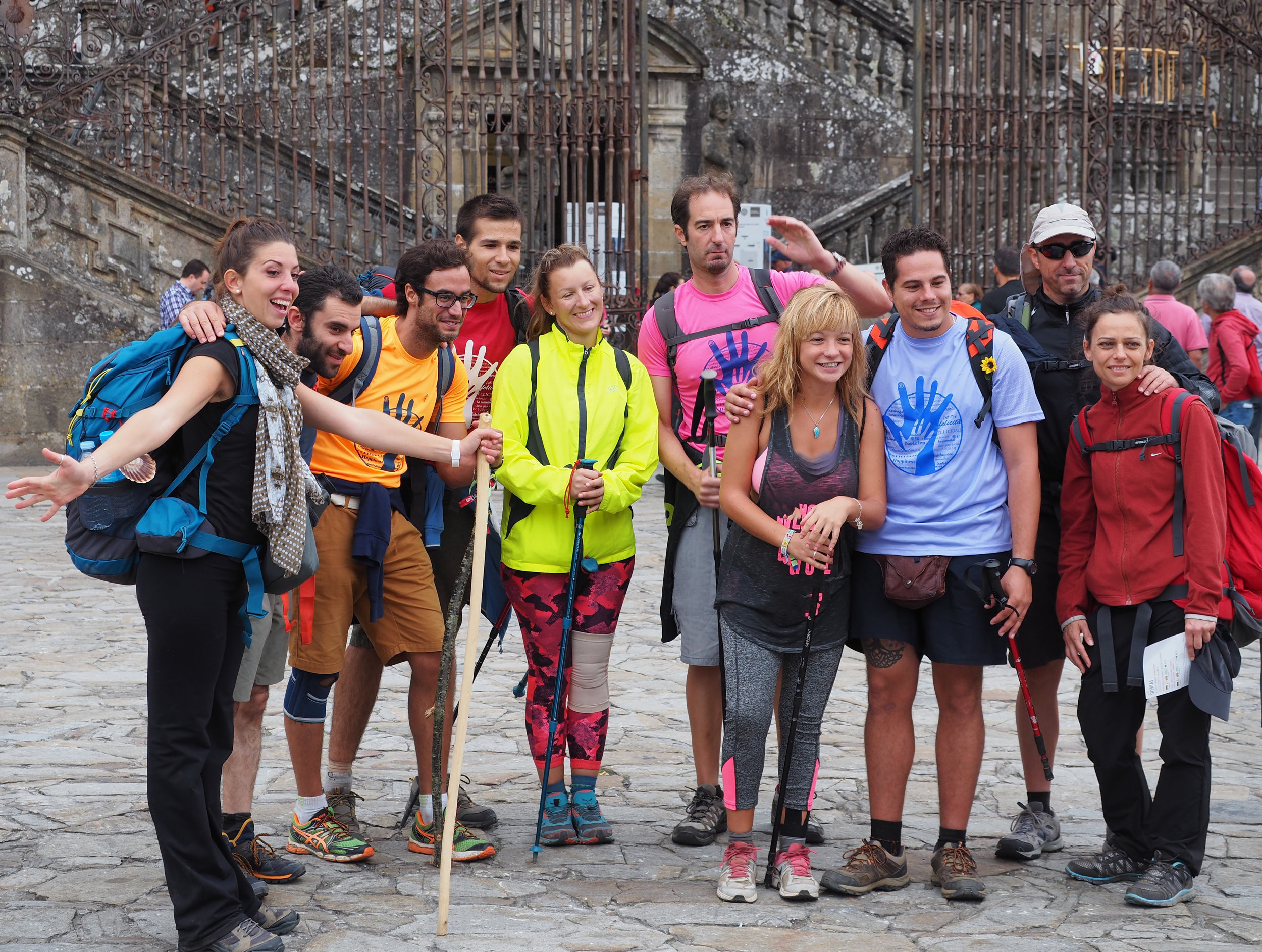 This group of Camino friends is celebrating their arrival in Santiago.Our goal is to help you get there, too.