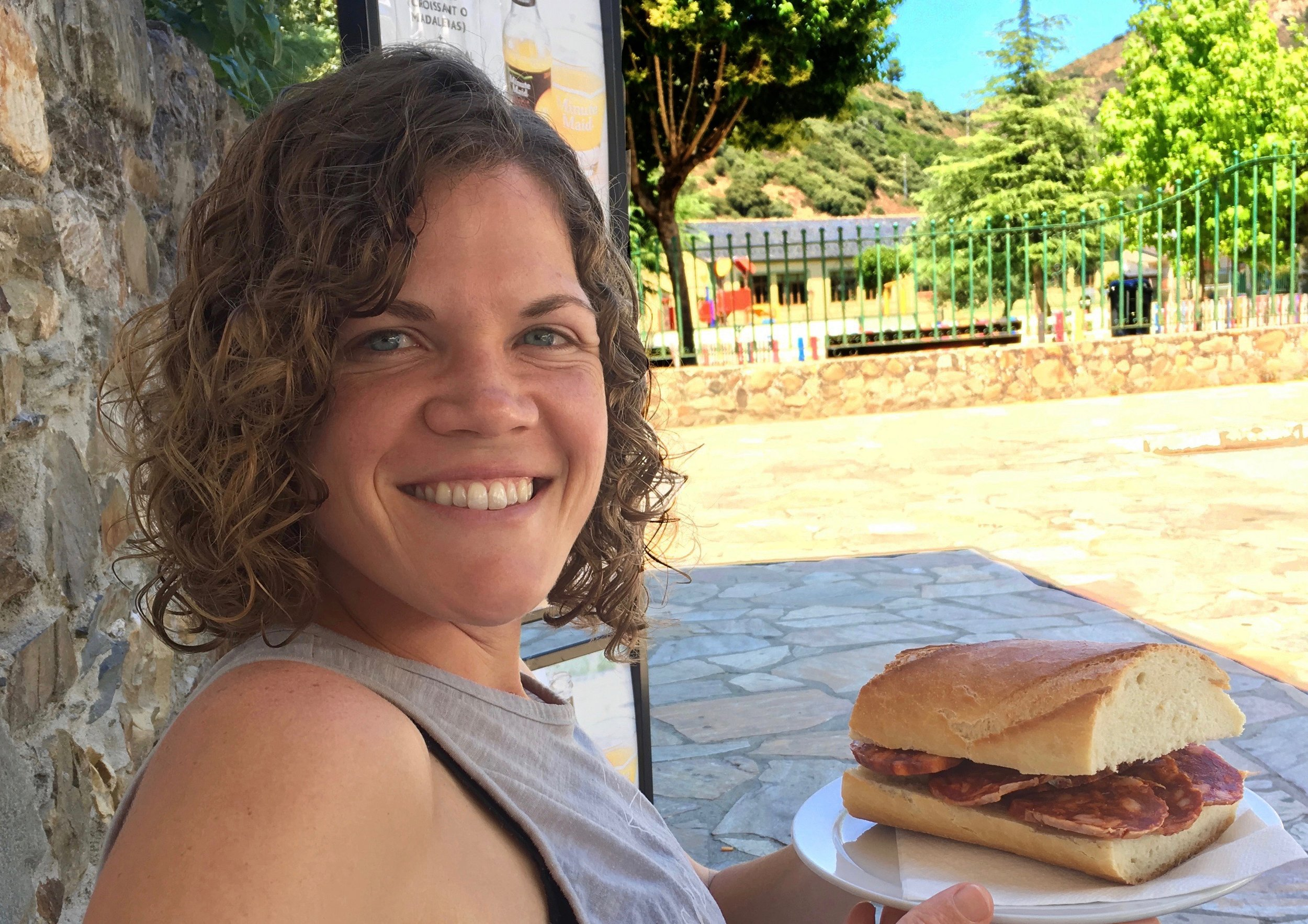Stephie with a bocadillo on the Camino Francés.