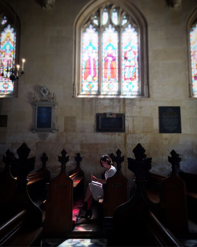 "Retrospective No.2: Turning a page in Sudeley Castle Chapel under Jane Grey's window. Reviewing what I wrote here, I find that the topic was ""usefulness."" Catherine Parr lying entombed just feet from me - the final wife of Henry 8 - more importantly was a woman who published her own prayers and thoughts on faith in 1545. Her life motto was ""to be useful in everything that I do"". I think it's easy as an artist and writer to question - am I useful? Who am I serving? The work, the words, the audience, or my image? Jane Grey lived here with Catherine as a young teen, just years before her own queendom, imprisonment, and death. Jane saw many women go before her who desired only one thing - to be useful to God, and be faithful to do what's in front of you. In my play Jane sits among a circle of New York women, but I don't know yet who's learning from whom. #newplay #playwright"