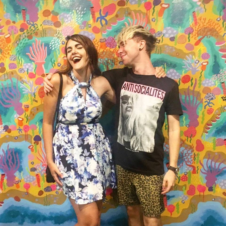 """Myself and Aaron on the opening night of """"It's Getting Hot in Here"""" and standing in front of his mural """"Great Barrier Reef."""" It's awesome supporting friends who succeed in what they do!"""
