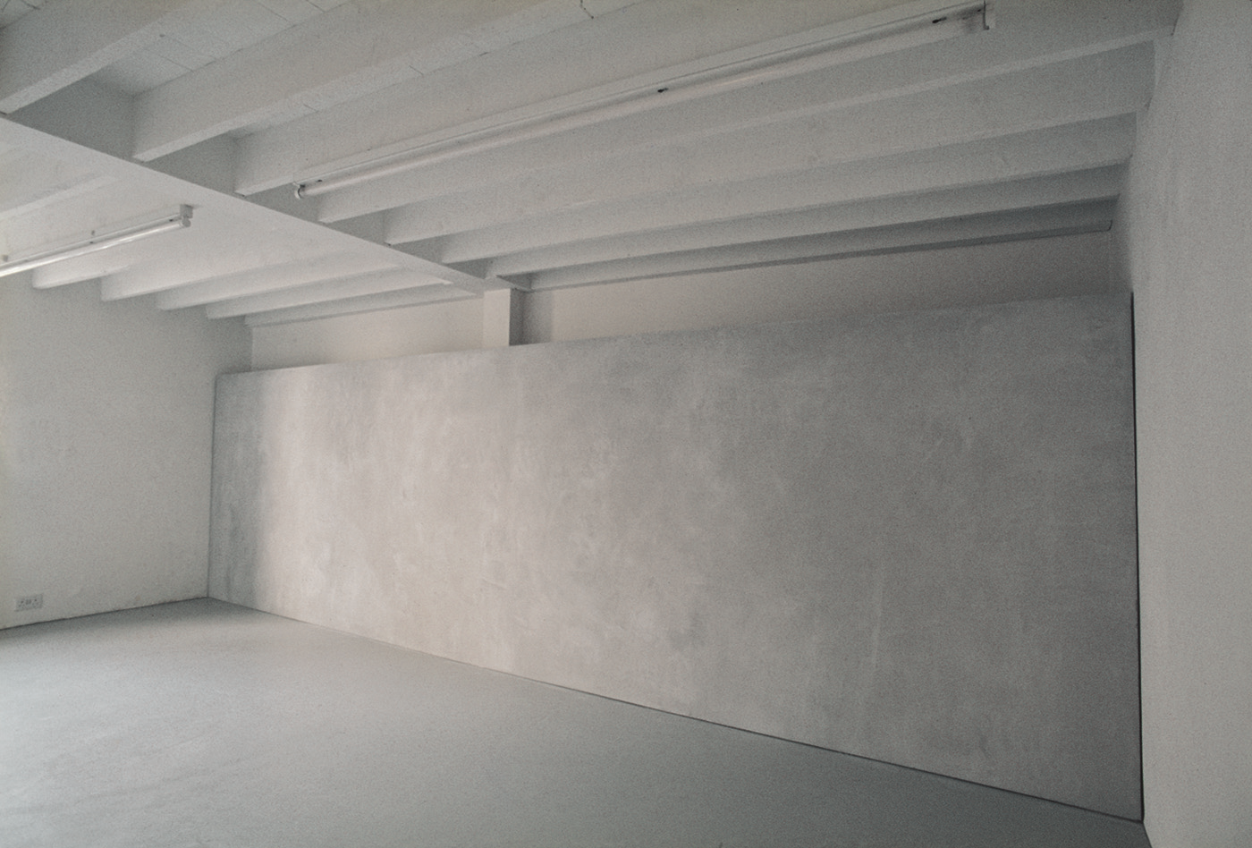 "Surface: Untitled I , 1976  Grey Building Plaster on Plasterboard with Galvanised Beading  183cm (72"") x 620cm (244"")  Installation at Lisson Gallery, London"