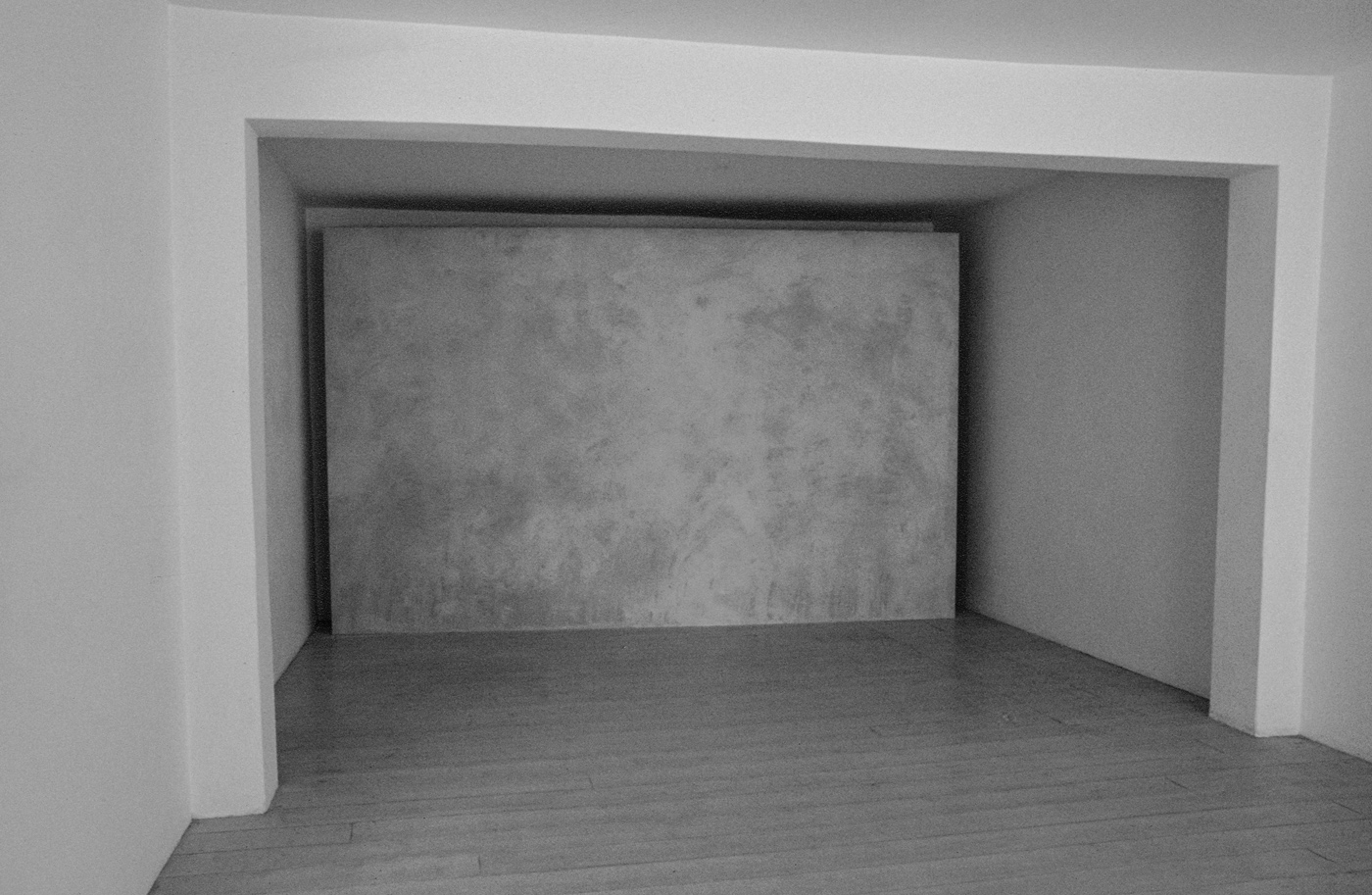 "Surface: Untitled III , 1976  Grey Building Plaster on Plasterboard with Galvanised Beading  244cm (96"") x 406cm (160"")  Installation at Lisson Gallery, London"