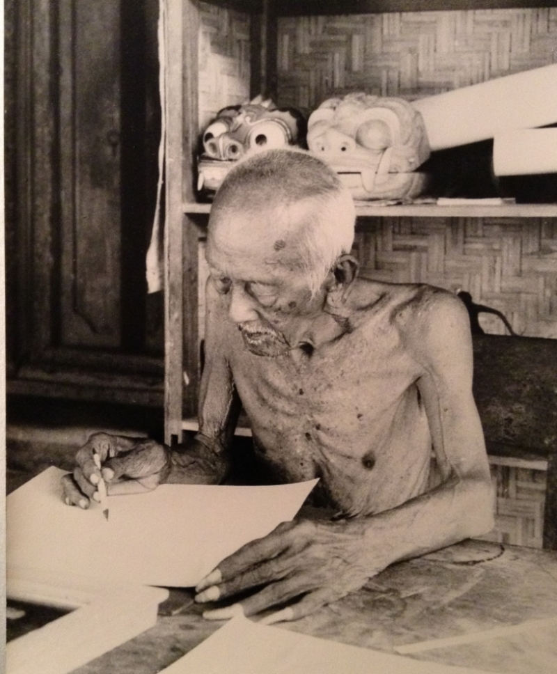 Lempad, still working in his Ubud home at age 111, is shown sketching a design for a stone frieze at a friend's house, in September 1973.