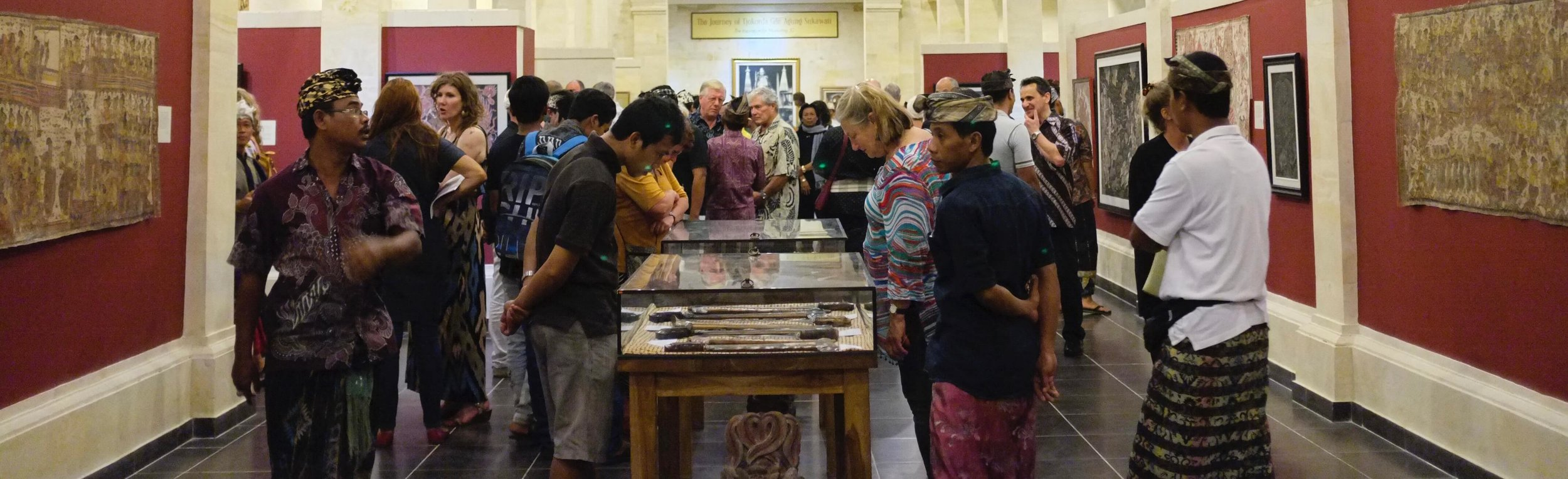 """The Museum Puri Lukisan in Ubud welcomed more than 300 guests for the opening of """"Ketut Madra and 100 Years of Balinese Wayang Painting."""""""