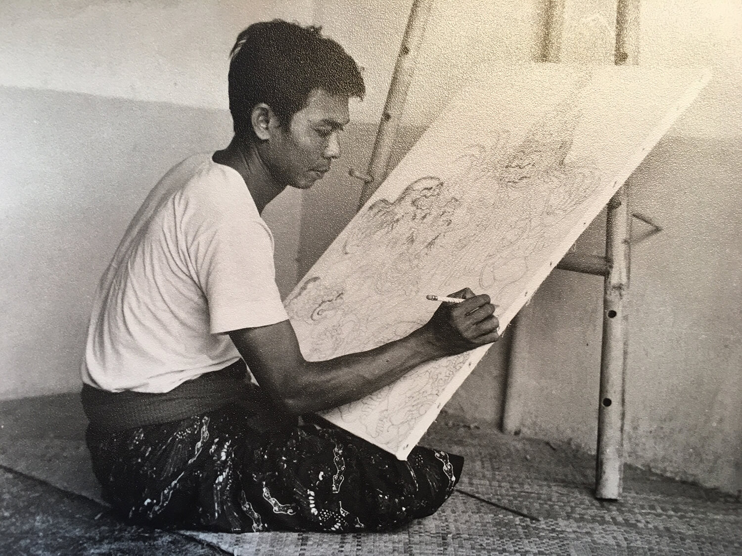 "Madra, at 33, developing the pencil sketch for a painting of ""Tenung Gana"""