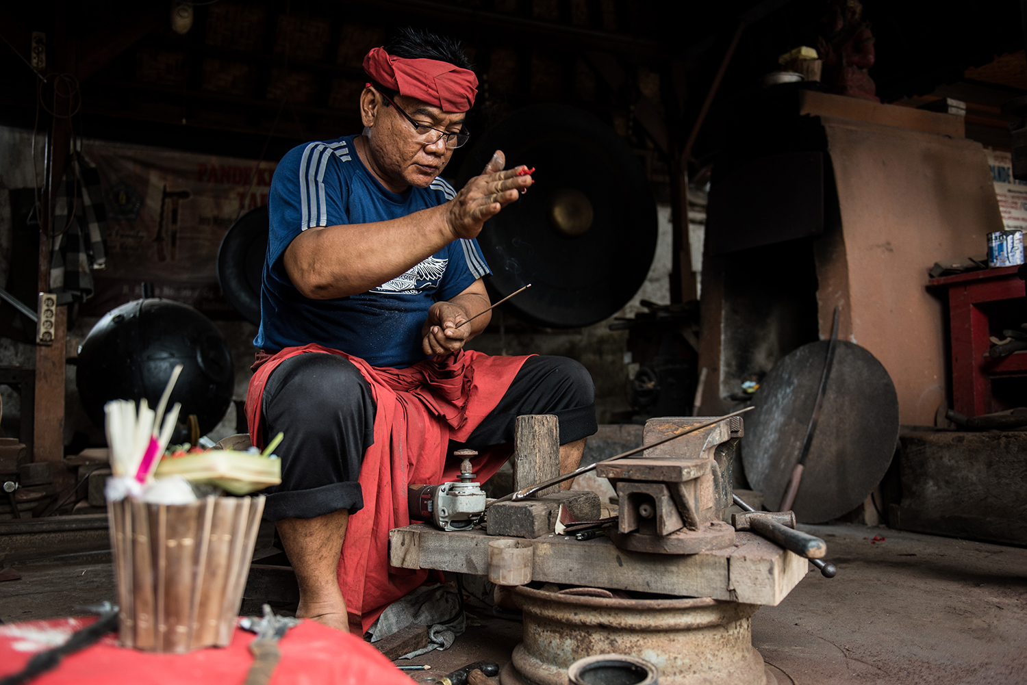 There are still a few smiths making keris in Bali. Here Pandé Nyoman Budiana of Tatasan prays before beginning work.