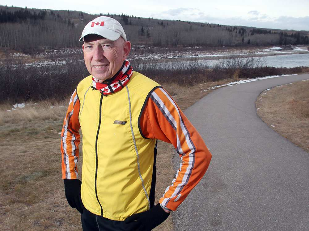Marathon runner Martin Parnell jogs along the Bow River pathway near his Cochrane home.    TED RHODES / CALGARY HERALD