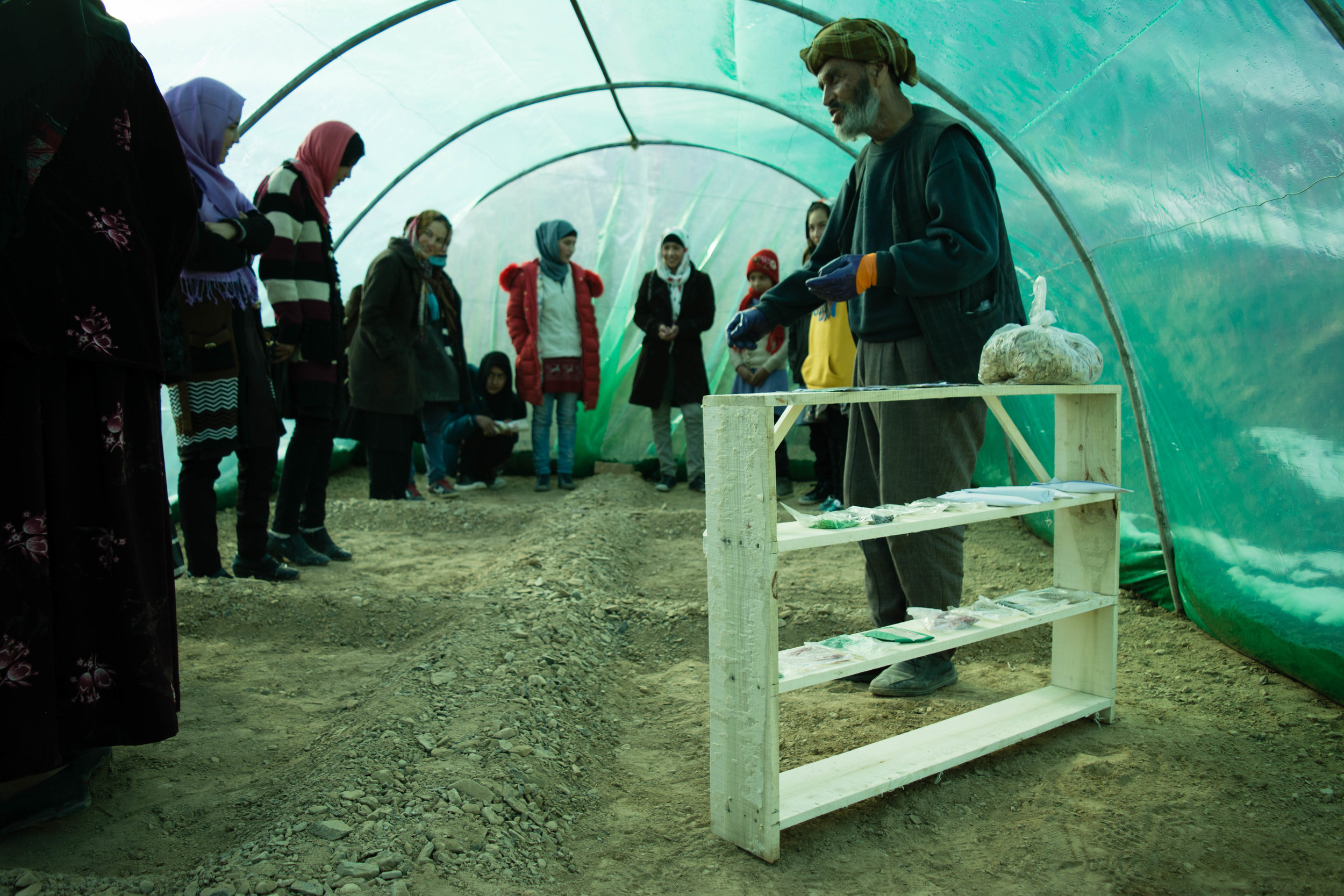 NGO partner COAM, delivers environmental lessons to students in a local greenhouse