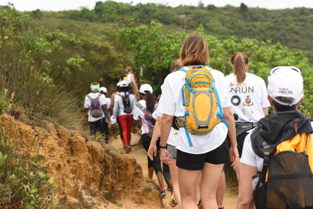 Volunteers and refugees out on one of their regular hikes around Hong Kong island