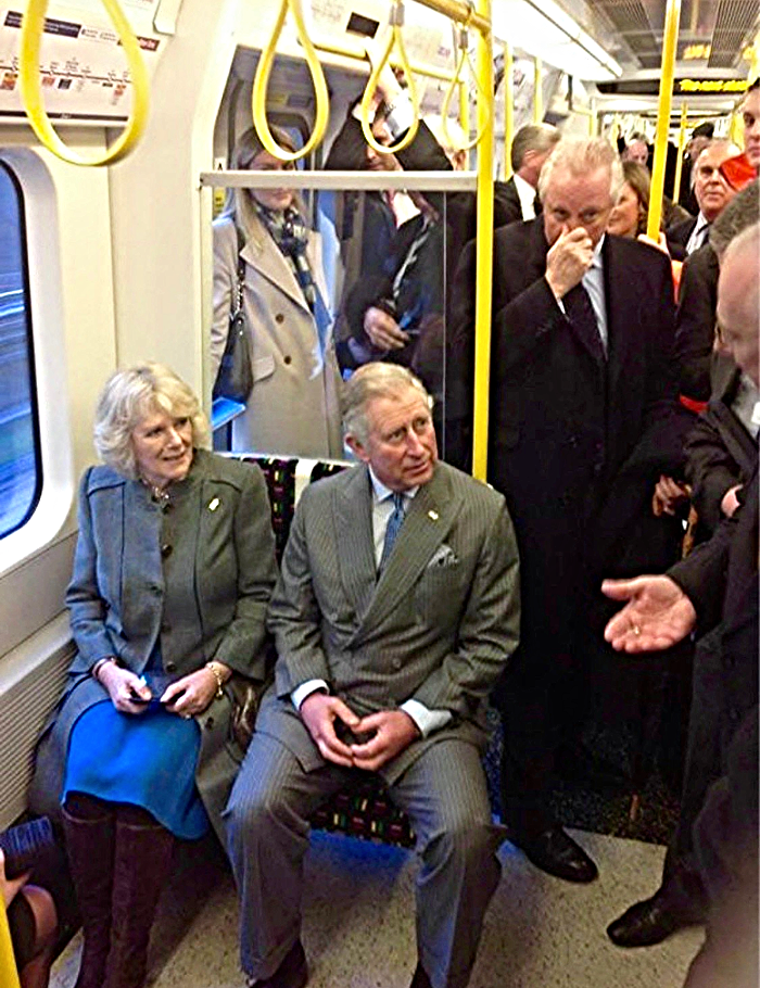 Prince Charles and Camilla riding the London Tube