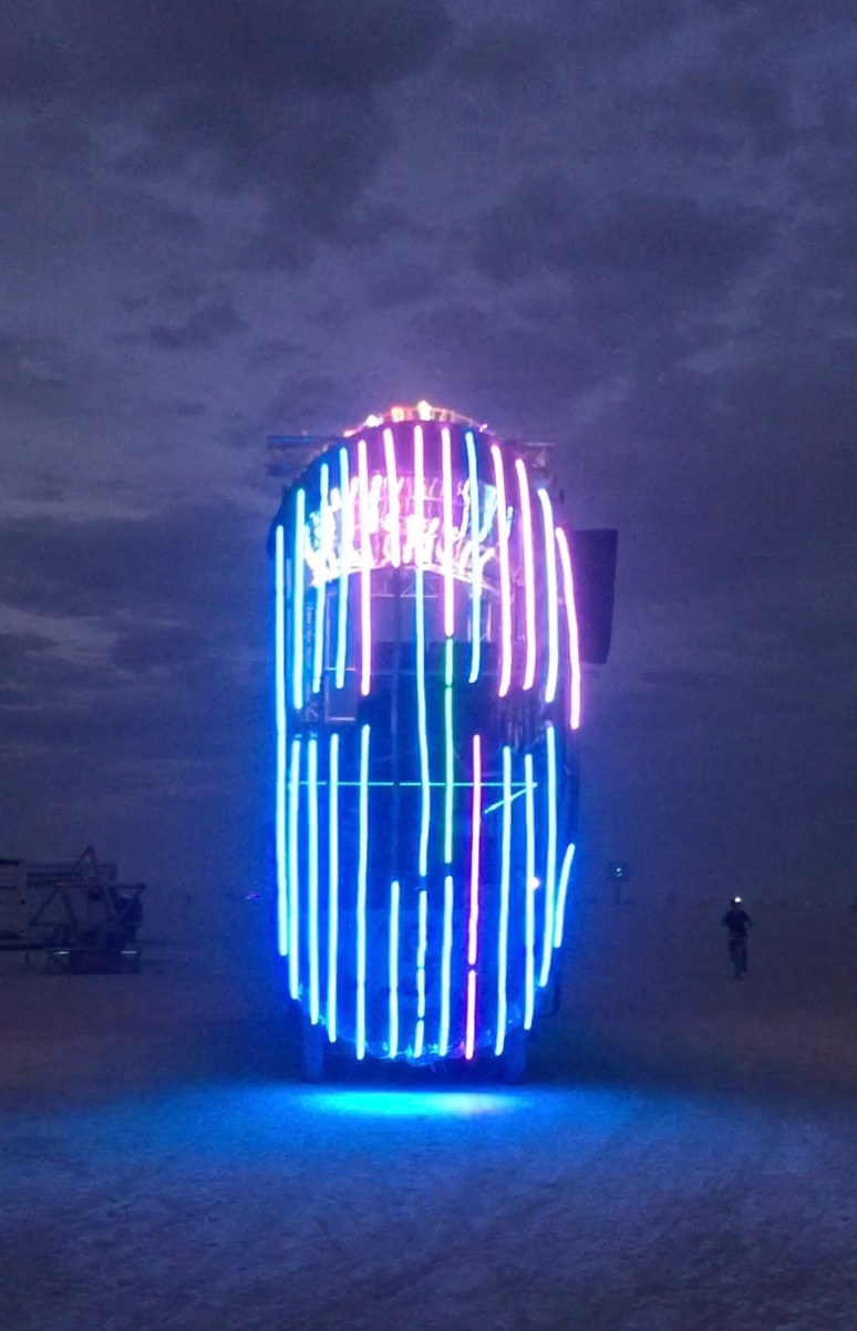 Music played from the neon face art car while a young girl danced.  Click to see video.