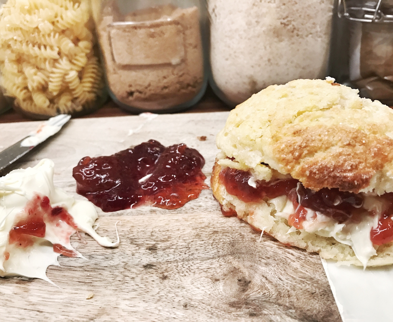Scone with clotted cream and jam.