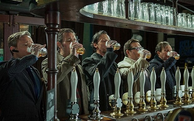 Lining up to chug beer at a pub