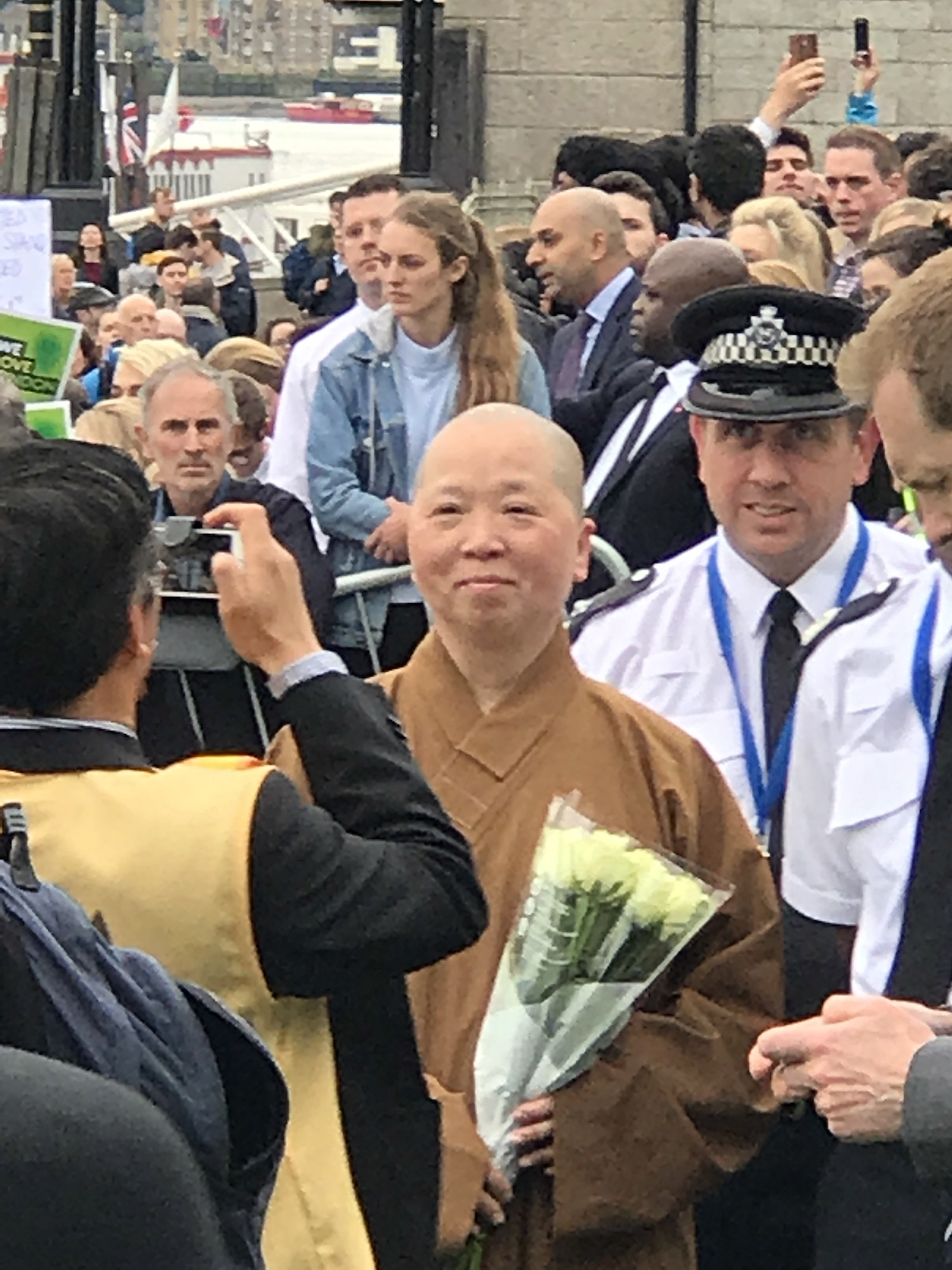 A Monk with flowers paying his respects for the victims of the London Bridge Terrorist Attack