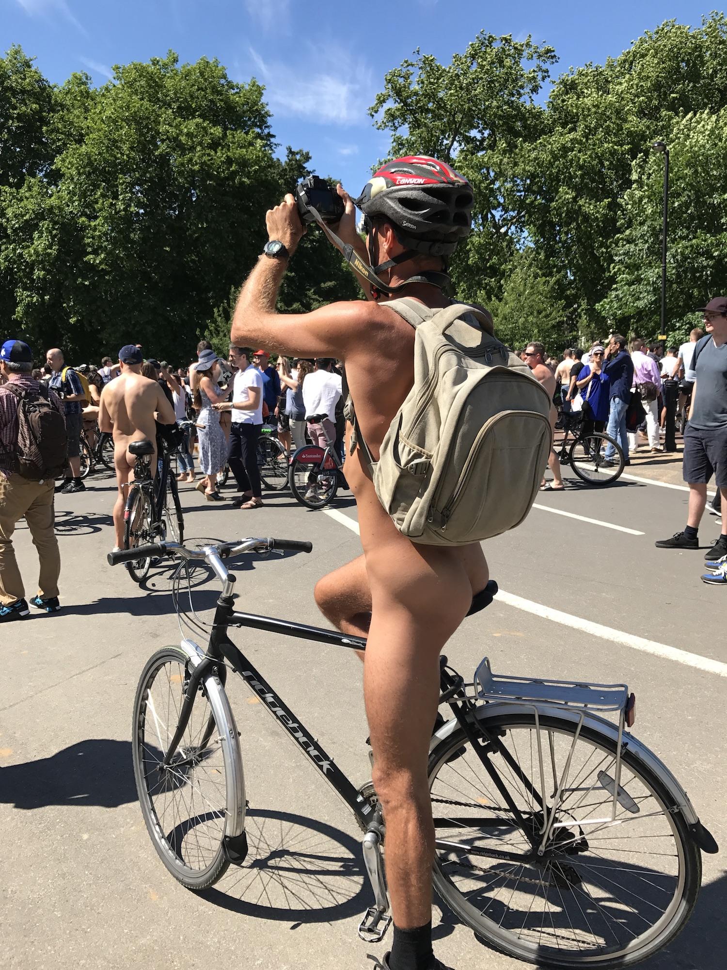 Naked Bike Rider Taking Photos. World's Naked Bike Ride London 2017