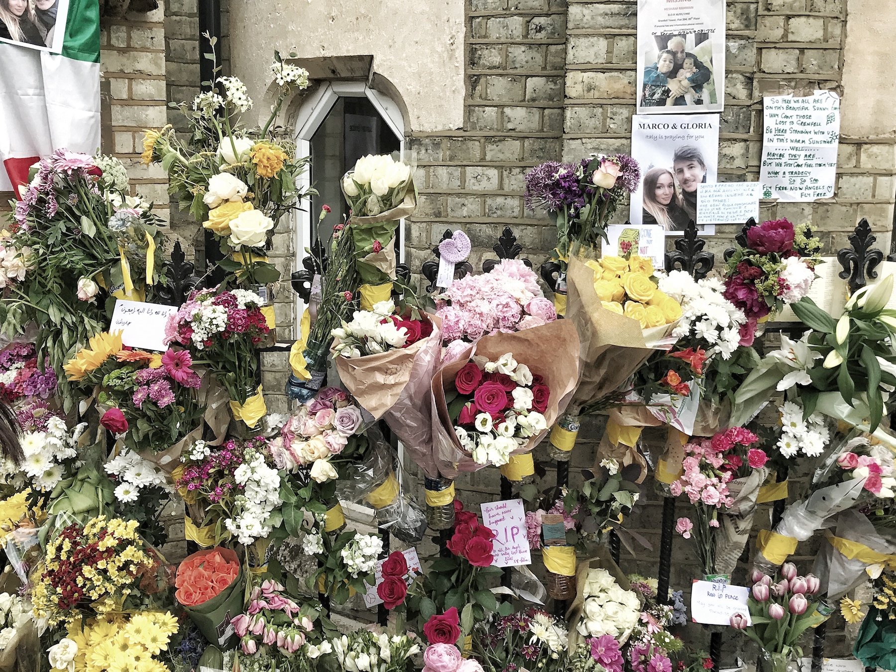 Tributes of flowers, candles and notes in the neighbourhood church by Grenfell Tower. London
