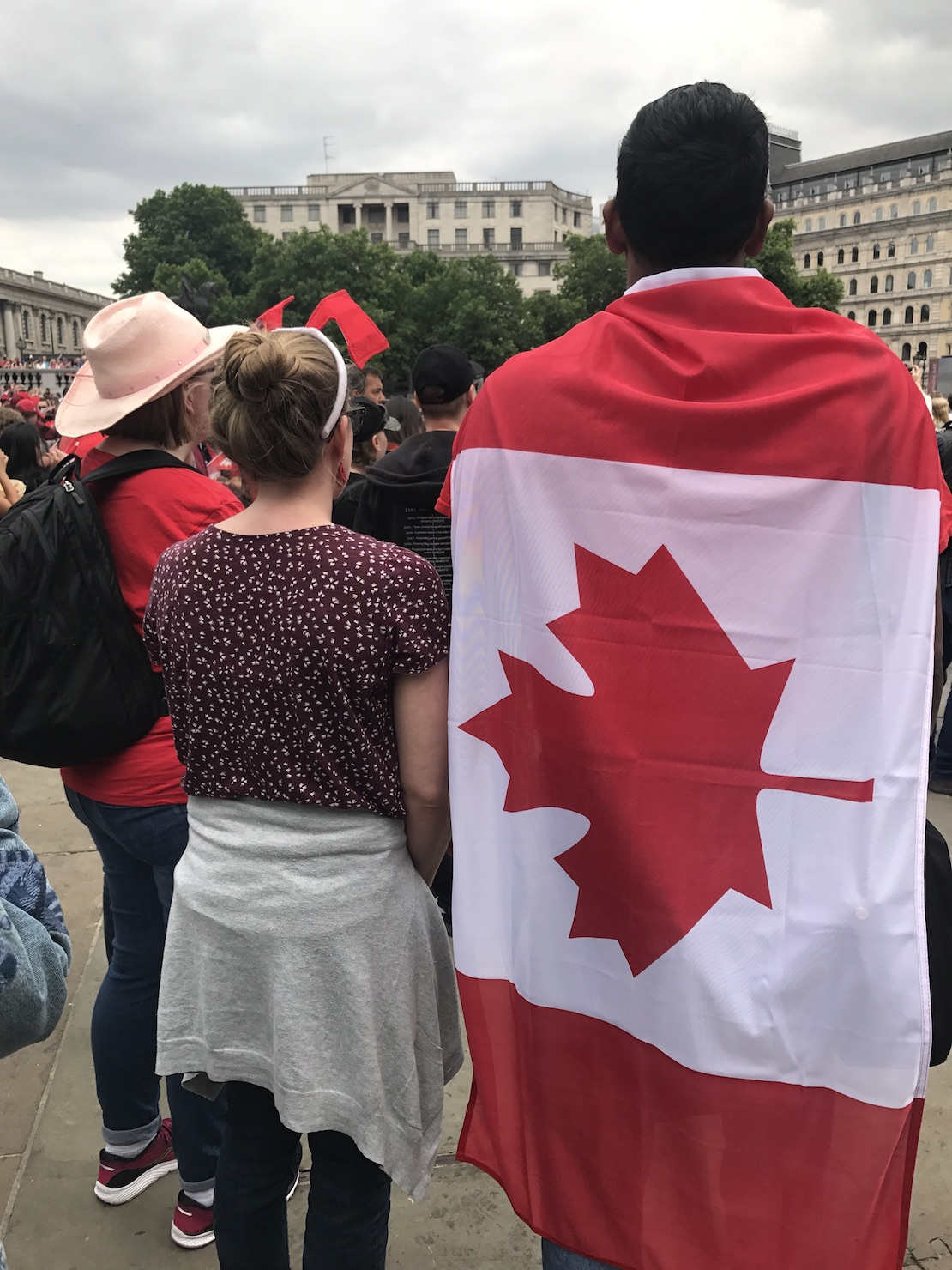 Wrapped in the Canadian flag at the Canada Day celebration at Trafalgar Square, London