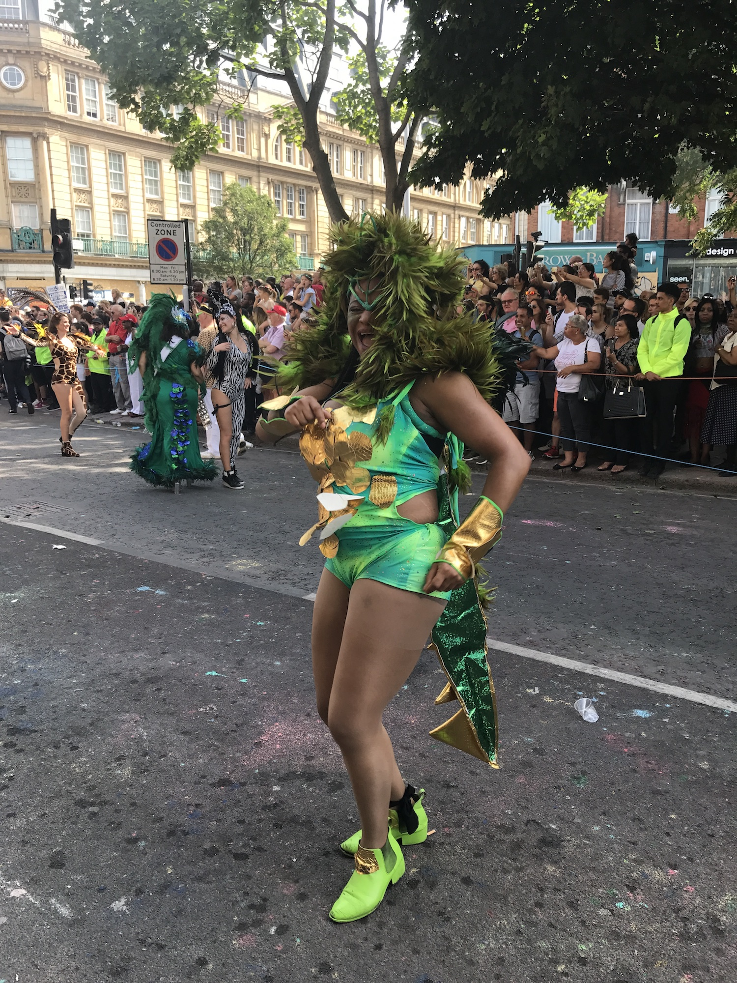 Dancing Lady in Green. Notting Hill Carnival 2017