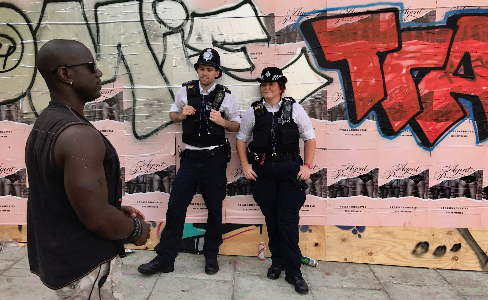 Cops Checking Out the Man. Notting Carnival London. 2017