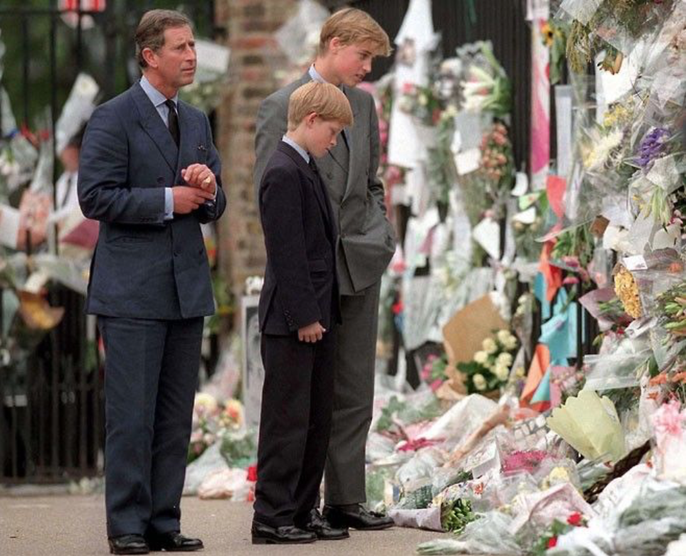 Young Princes looking at the flowers for their mother Princess Diana