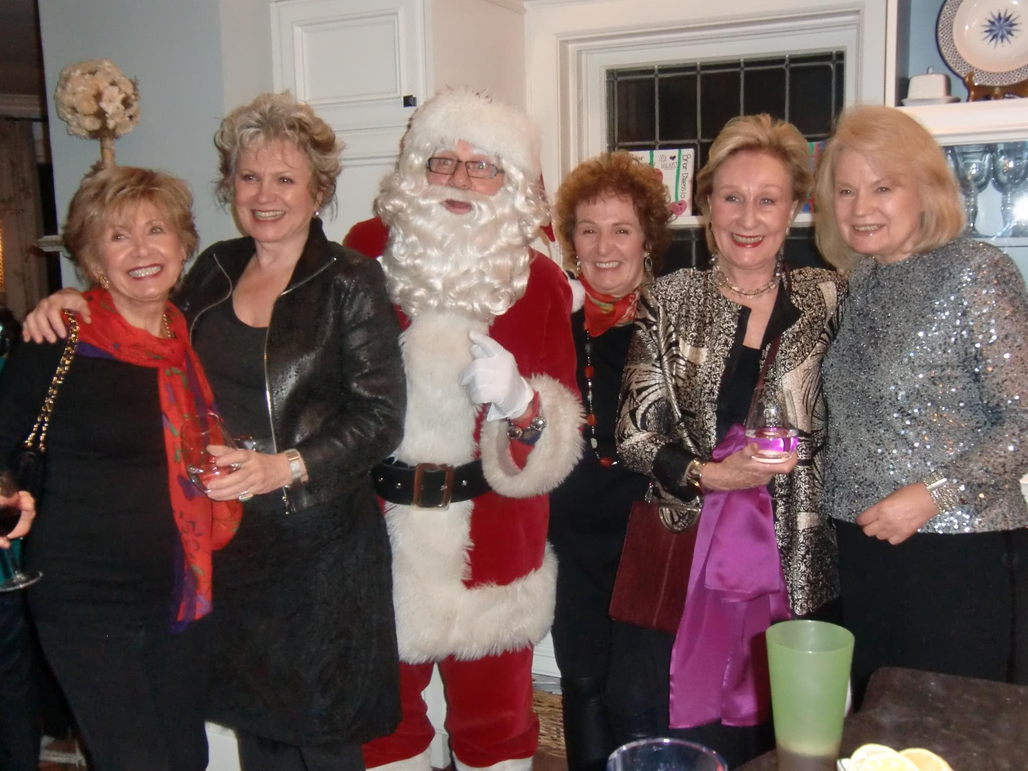 Elena (far right) and her posé...and of course Santa