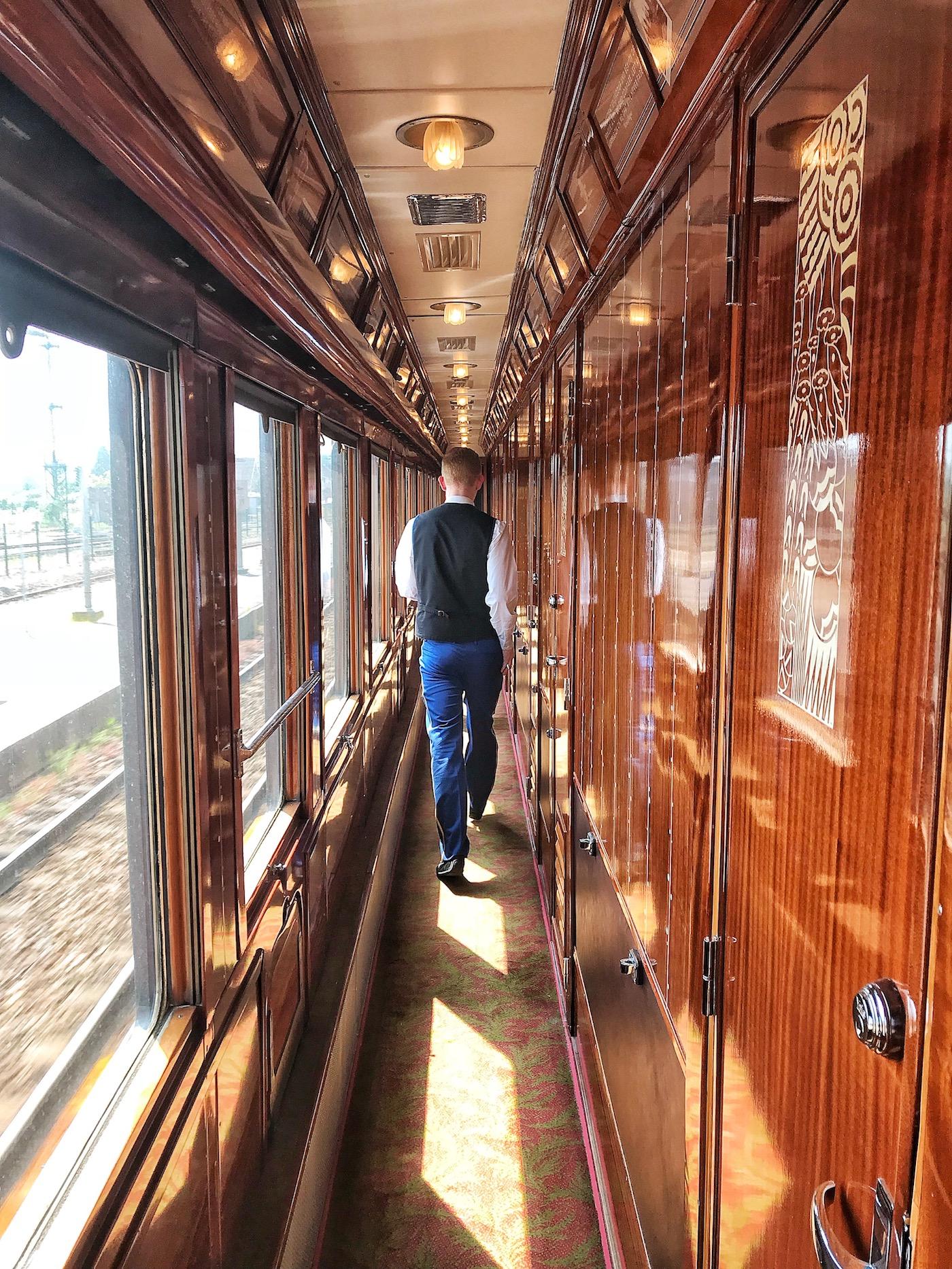 Butler Along Corridor onboard The Orient Express.jpg